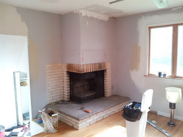 Diy built ins next to fireplace for Building a corner fireplace