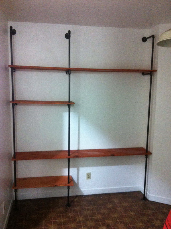 How to build a plumbing pipe shelving wall unit easy diy for Easy diy shelves