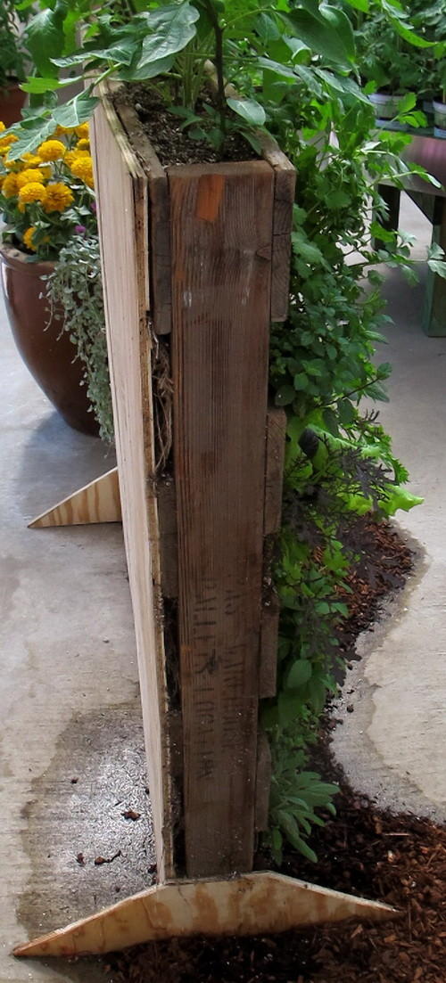 Pallet garden with feet built to stand vertically