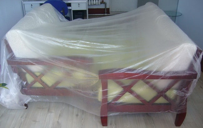 put plastic drop sheeting over furniture