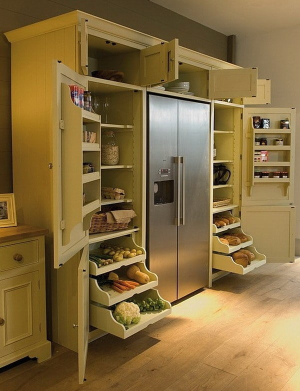 kitchen remodel with sliding shelves above and on the side of the refrigerator