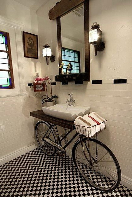 Old bike in a bathroom