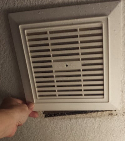 How to replace a noisy or broken bathroom vent exhaust fan for Bathroom exhaust fan cover