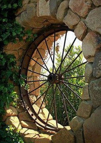 old metal wagon wheel turned into patio art window