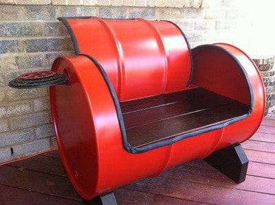 recycled oil drum turned into a cushioned bench