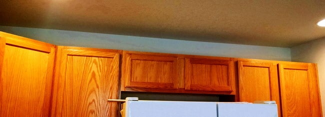 How to install crown molding to kitchen cabinets us3 for Oak crown molding for kitchen cabinets