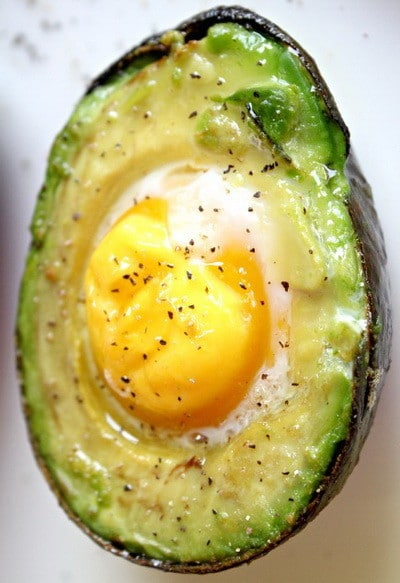 fried egg on top of avocado