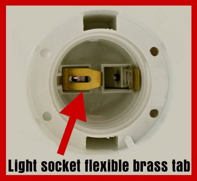 Light socket brass tab