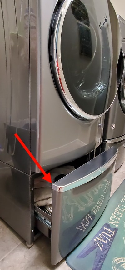 Noisy washer - Washing machine pedestal drawer is open